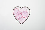 Opaque hearts in a heart cookie cutter.