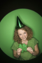 Royalty Free Photo of a Woman Wearing a Party Hat and Holding a Shamrock