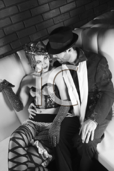 Royalty Free Photo of a Man in a Retro Suit Sitting With a Woman in Retro Wear