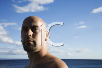 Royalty Free Photo of a Bald Male Portrait on a Beach