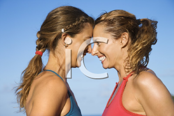Royalty Free Photo of Women With Heads Together Smiling