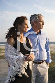 Royalty Free Photo of a Couple Looking Off to the Side at the Beach