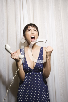 Royalty Free Photo of a Woman Holding a Telephone Receiver and Screaming