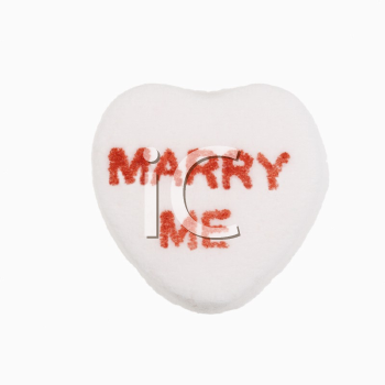 Royalty Free Photo of a White Candy Heart That Reads Marry Me