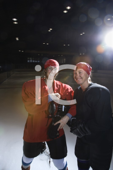 Royalty Free Photo of Female Hockey Players in Posing on an Ice Rink