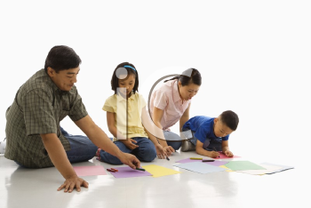 Royalty Free Photo of Parents Coloring With Their Children