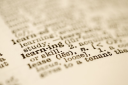 Royalty Free Photo of a Selective Focus of a Dictionary Definition for the Word Learning