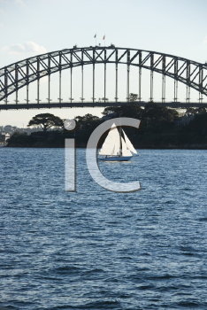 Royalty Free Photo of the Sydney Harbour Bridge and a Sailboat in Sydney, Australia