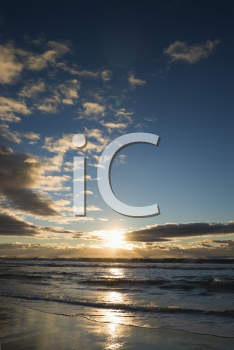 Royalty Free Photo of Cumulus Clouds at Sunset Over Ocean in Surfers Paradise, Australia
