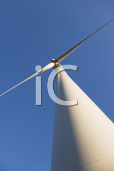 Royalty Free Photo of a Wind Turbine Against a Blue Sky