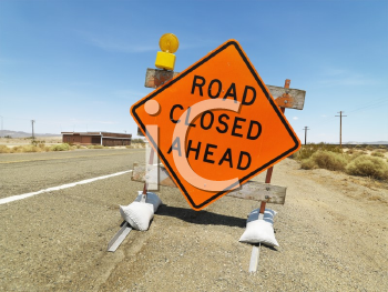 Royalty Free Photo of a Road Sign on a Rural Highway Warning That a Road is Closed Ahead