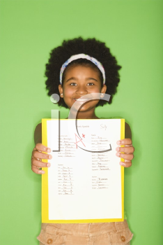 Royalty Free Photo of a Girl Holding a School Assignment and Smiling Proudly
