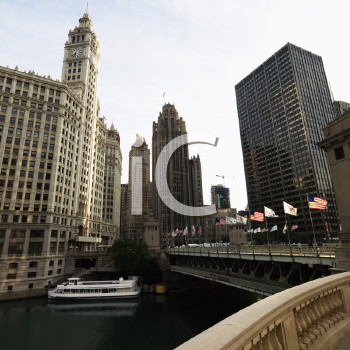 Royalty Free Photo of the Chicago River Scene With Bridge and Boat in Chicago, Illinois