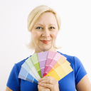 Royalty Free Photo of a Smiling Blonde Woman Holding Paint Swatches