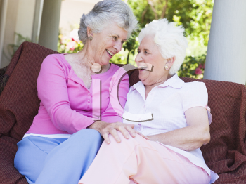 Royalty Free Photo of Two Senior Women Sitting Outside