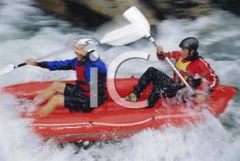 Royalty Free Photo of Two Kayakers in Rapids
