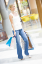 Royalty Free Photo of a Woman Shopping in a Mall