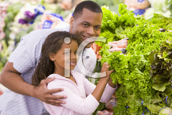 Royalty Free Photo of a Father and Daughter Shopping