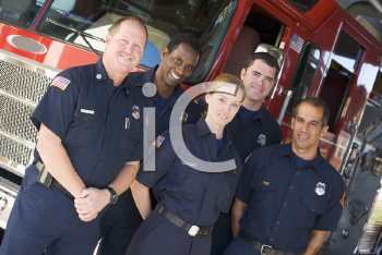 Royalty Free Photo of Firefighters Beside a Truck