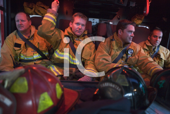 Royalty Free Photo of Firefighters in Bunker Suits
