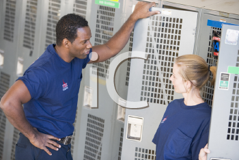 Royalty Free Photo of Two Firefighters Talking in a Locker Room