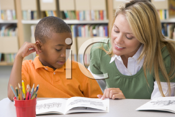 Royalty Free Clipart Image of a Student Reading in Class