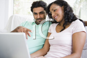 Royalty Free Photo of a Couple With a Laptop