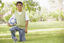 Royalty Free Photo of a Boy With a Soccer Ball in the Park