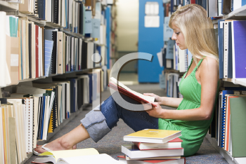 Royalty Free Photo of a Girl on the Library Floor