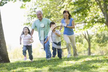 Royalty Free Photo of Grandparents Running With Their Grandchildren