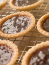 Royalty Free Photo of Jam Tarts on a Cooling Rack