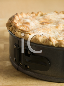 Royalty Free Photo of a Deep Apple Pie in a Baking Tin