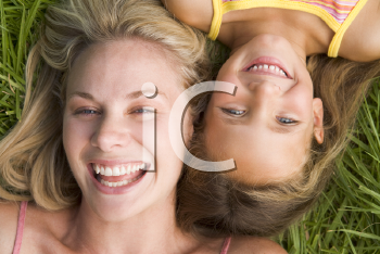 Royalty Free Photo of a Woman and Young Girl Lying in the Grass
