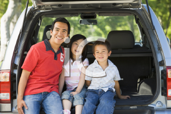 Royalty Free Photo of a Man With Two Children in a Hatchback