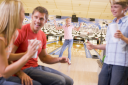 Royalty Free Photo of a Family Bowling
