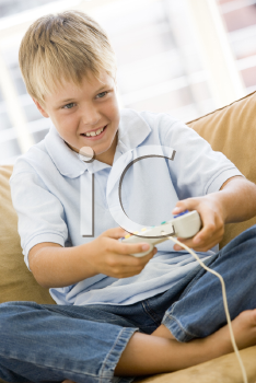 Royalty Free Photo of a Boy Playing Video Games