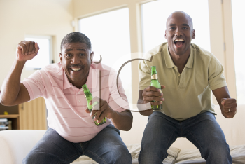 Royalty Free Photo of Two Men Cheering With Beer