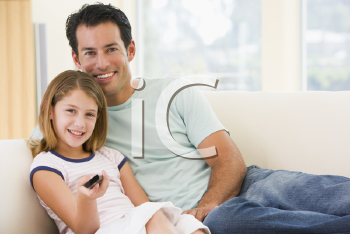 Royalty Free Photo of a Father and Daughter With a Remote
