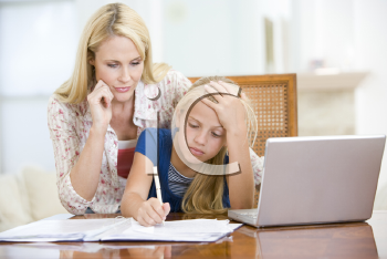 Royalty Free Photo of a Mother Helping Her Daughter With Homework