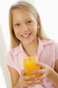 Royalty Free Photo of a Girl With a Glass of Orange Juice