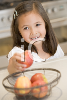 Royalty Free Photo of a Girl Getting an Apple