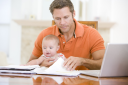 Royalty Free Photo of a Father and Child at a Laptop