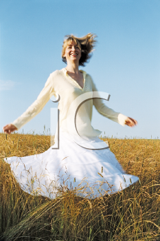 Royalty Free Photo of a Woman Spinning Outside