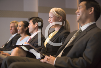 Royalty Free Photo of People Listening to a Presentation