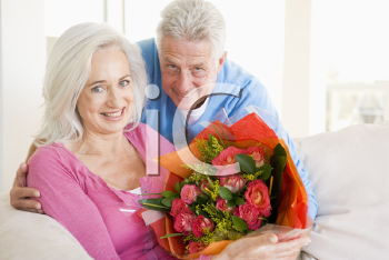 Royalty Free Photo of a Man Giving His Wife Flowers
