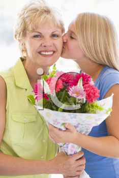 Royalty Free Photo of a Girl Giving a Woman Flowers