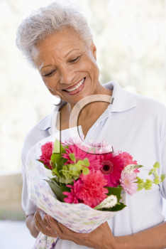 Royalty Free Photo of a Woman Holding Flowers