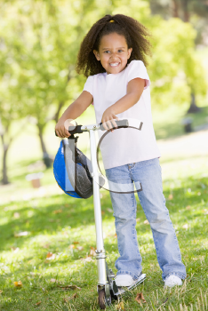Royalty Free Photo of a Little Girl on a Scooter