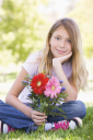 Royalty Free Photo of a Little Girl Holding Flowers