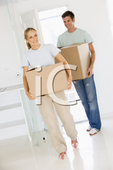 Royalty Free Photo of a Couple Moving Into a New Home